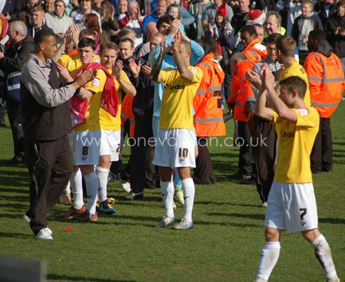 Players applaud the fans