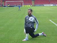 Jak Alnwick stretches at Crewe