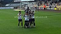 Celebrations after Remie Streete's goal