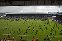 Crowd invade the pitch