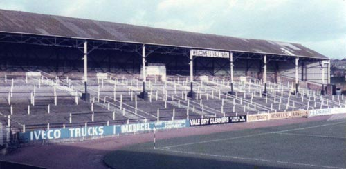 """A second image showing the much-missed """"Welcome to Vale Park"""" sign and a patched up corrugated iron roof"""