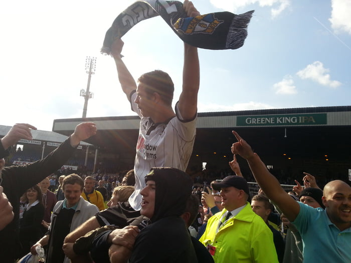 Tom Pope chaired aloft after promotion in 2013