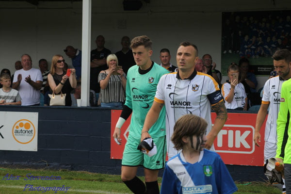 Captain Antony Kay walks out