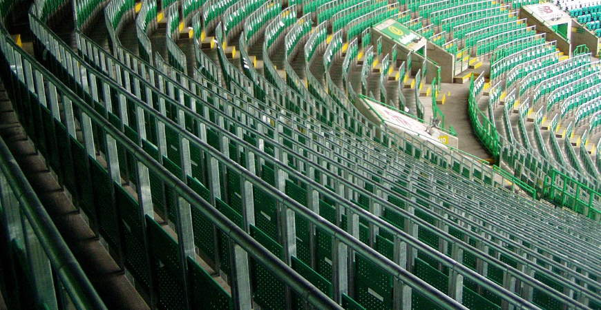 """""""File:Celtic FC rail seating section.jpg"""" by Jon Darch is licensed under CC BY-SA 4.0"""