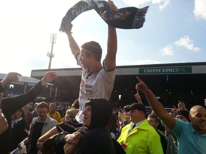 Tom Pope is carried aloft by the crowd - Port Vale v Northampton Town 2013