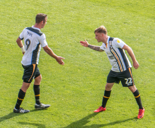 Tom Conlon and Tom Pope exchange a high five