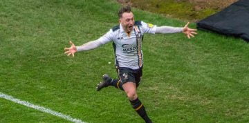 Ricky Miller celebrates scoring against Mansfield Town.