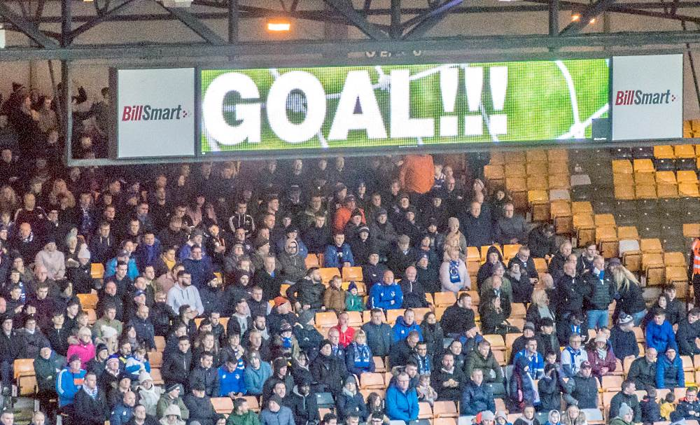 Oldham fans are nonplussed as a Vale goal is signaled on the scoreboard.