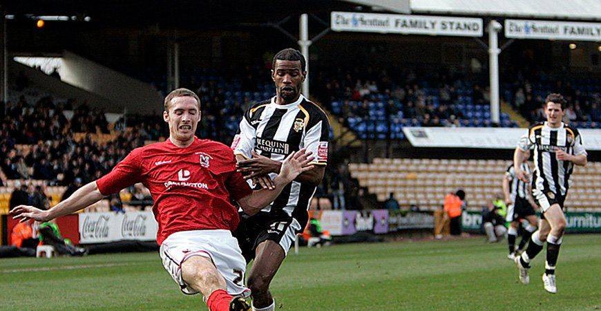 Paul Edwards challenges as Rob Taylor moves in to assist