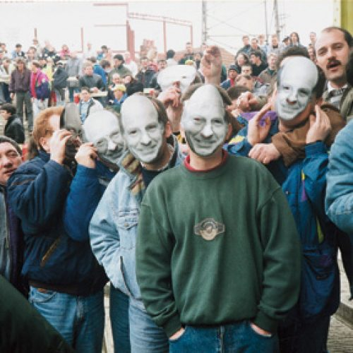 Port Vale fans with John Rudge masks at Swindon Town