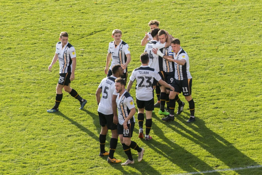 Vale players celebrate Tom Pope's winner against Bury in 2018