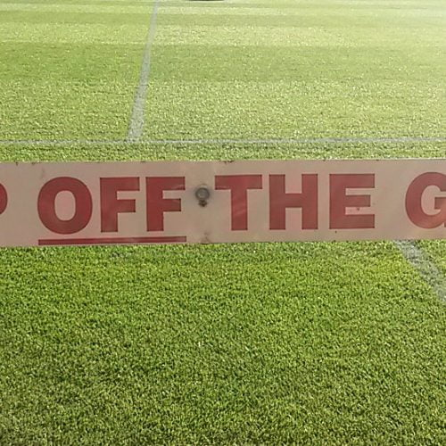 Keep off the grass sign at Vale Park