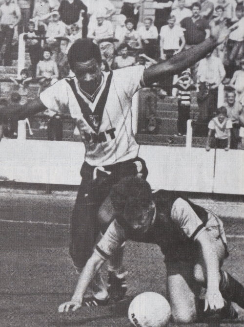 A young Mark Bright in action