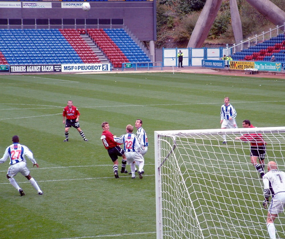 Port Vale play in a red kit at Huddersfield Town