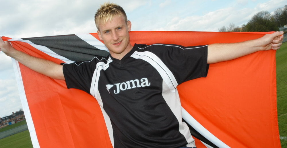 Port Vale winger Chris Birchall with the Trinidad and Tobago flag