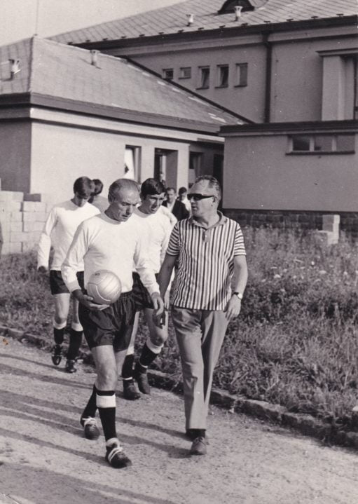 Sir Stanley Matthews (with John James and Mick Cullerton in the background) leads the team out for the game against Skuter.