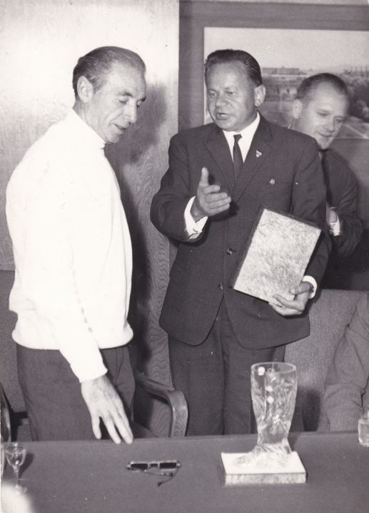 Sir Stanley Matthews receives a cut glass boot in the boardroom at Czechglass.