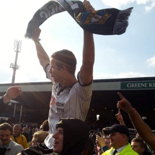 Tom Pope held aloft by the fans after promotion in 2013