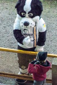 Boomer and young fan during the game against Colchester United.