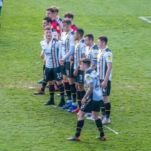 A Port Vale wall defends a free-kick