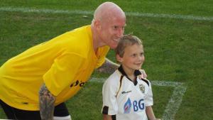 Lee Hughes and a mascot