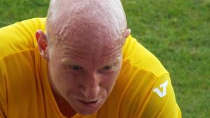 A shaven headed Lee Hughes