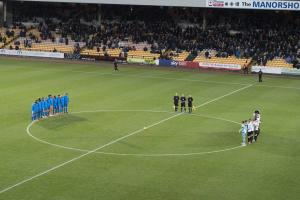 A minute's silence before the Port Vale v Notts County game