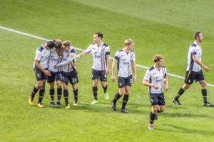 Luke Hannant is congratulated by team mates after his goal against Notts County