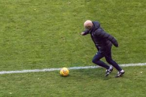 Manager Neil Aspin shows his skills as he retrieves the ball