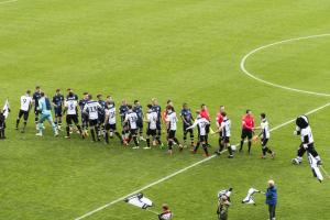 The teams walk out
