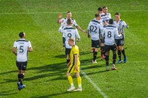 Vale players celebrate Montano's opener