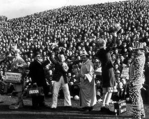 Mascots in front of the crowd as Port Vale play Blackpool in 1954