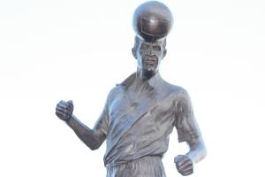 A front view of the Roy Sproson statue